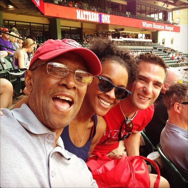 Dad, Devin, and me at a Houston Astros game... In our Cards gear (like true fans).